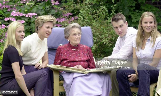 HRH Princess Alice with her daughterinlaw the Duchess of Gloucester and her grandchildren Lady Davina Windsor Lady Rose Windsor and Alexander the...