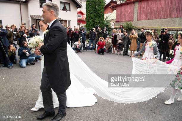 Princess Alina of Romania arrives with her godfather Liviu Popescu at Sfantul IIie church on September 30 2018 in Sinaia Romania