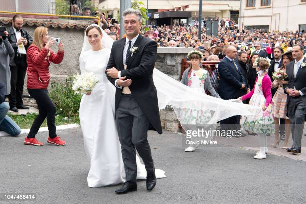Princess Alina of Romania arrives with her godfather Liviu Popescu for her wedding ceremony at Sfantul IIie church on September 30 2018 in Sinaia...