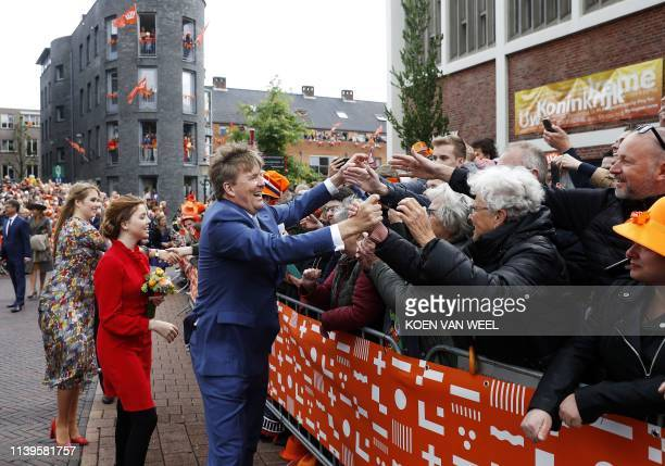 Princess Amalia, Princess Alexia and King Willem-Alexander shake hands in Amersfoort on Kings Day on April 27, 2019. - The king celebrates his...