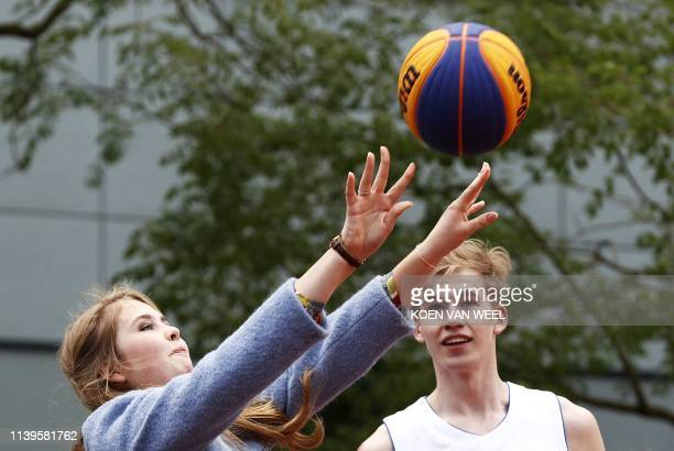 Princess Amalia throws a ball during a visit to Amersfoort on Kings Day on April 27 2019 The king celebrates his birthday in the city in central...