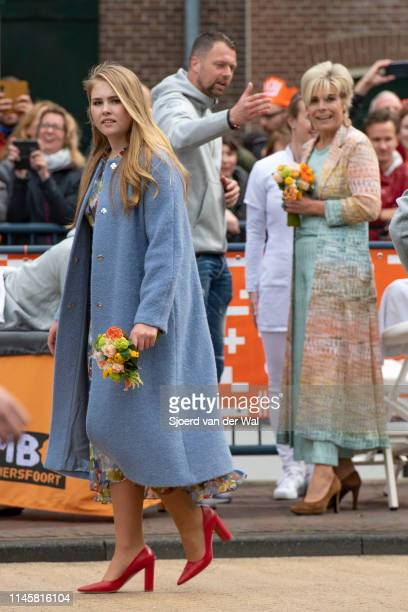 Princess Amalia with Princess Laurentien in the background during their visit to the city of Amersfoort to celebrate Kingsday on April 27 2019 in...