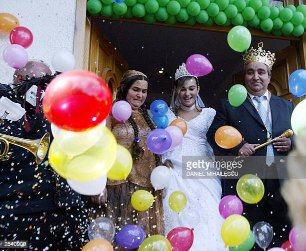 Princess Ana Maria is guided to her wedding by her father selfproclaimed King of the Gypsies Cioaba Florin in Sibiu 27 September 2003 Following Gypsy...