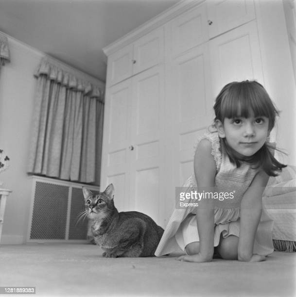 Princess Anna Christina 'Tina' Radziwill with her pet cat, 8th December 1965. She will be entering the animal in the cat show at Olympia in London....