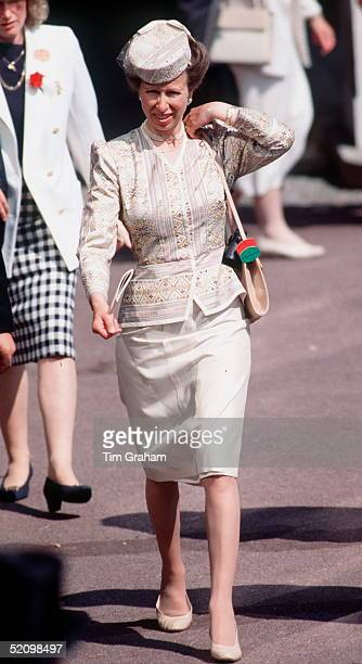 Princess Anne Adjusts Her Handbag On Her Shoulder While Walking Through The Crowds At Royal Ascot.