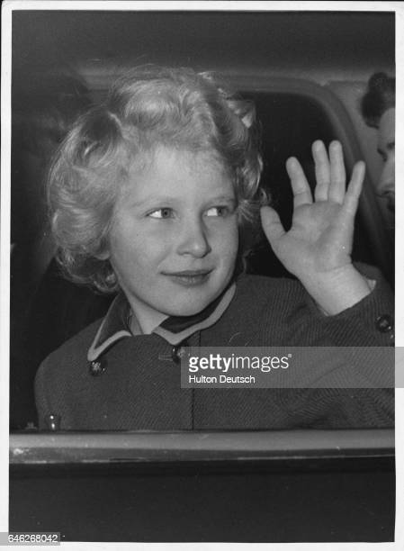 Princess Anne aged 6 waves as she leaves Buckingham Palace