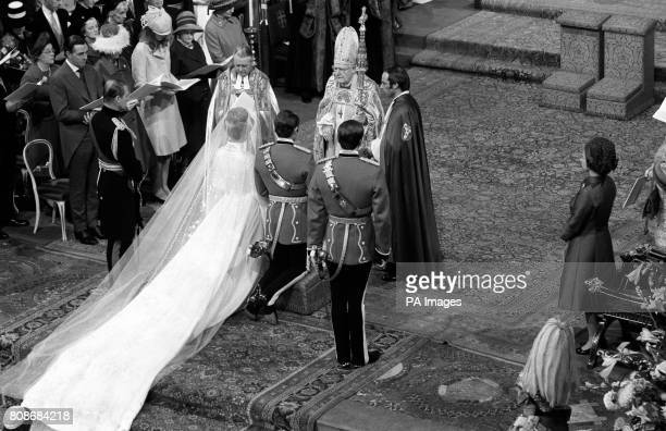 Princess Anne and Captain Mark Phillips kneel before the Archbishop of Canterbury Dr Michael Ramsey during their wedding in Westminster Abbey...