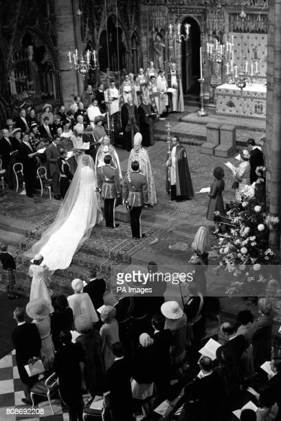 Princess Anne and Captain Mark Phillips stand before the Archbishop of Canterbury Dr Michael Ramsey and the Dean of Westminster Abbey Dr Eric Abbott...
