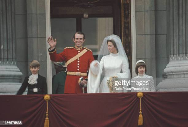 Princess Anne and Captain Mark Phillips wave from the balcony of Buckingham Palace following their wedding ceremony at Westminster Abbey in London on...