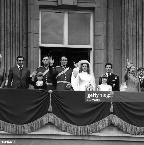 Princess Anne and Captain Mark Phillips wave from the Buckingham Palace balcony to thousands of wellwishers after their wedding With them from left...
