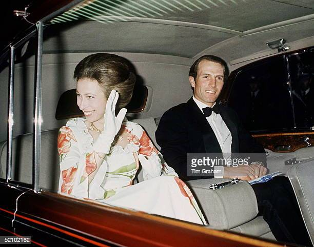 Princess Anne And Her Husband Mark Phillips Waving As They Leave The Dorchester Hotel In London In A Rolls Royce Limousine Car