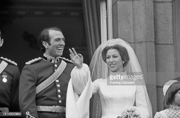 Princess Anne and Mark Phillips pose on the balcony of Buckingham Palace in London after their wedding, UK, 14th November 1973.