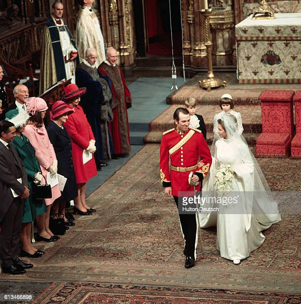 Princess Anne and Mark Phillips walk down the aisle together after being married at Westminster Cathedral