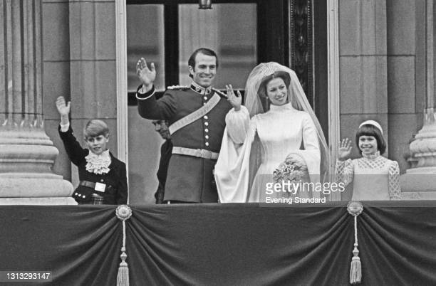 Princess Anne and Mark Phillips wave to the crowds from the balcony of Buckingham Palace in London, UK, on their wedding day, 14th November 1973. On...