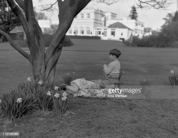 Princess Anne and Prince Charles playing in the garden of the Royal Lodge in Windsor England on April 07 1954
