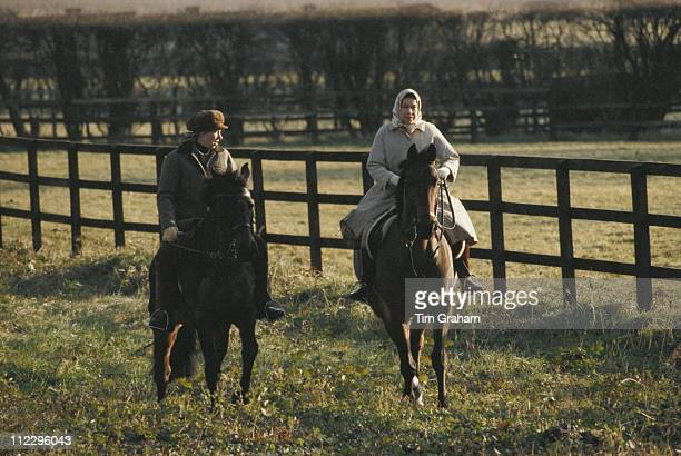 Princess Anne and Queen Elizabeth II horse riding on the Sandringham estate in Sandringham, Norfolk, England, Great Britain, circa 1979. Neither is...