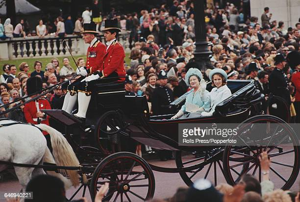 Princess Anne and Queen Elizabeth The Queen Mother ride together in an open landau horse drawn coach past the Victoria Memorial at the end of The...