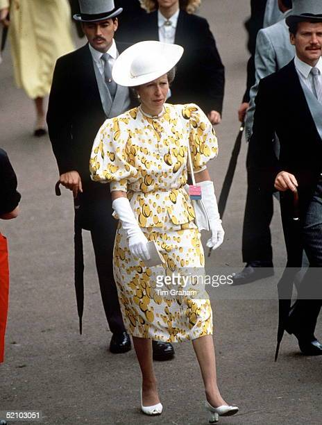 Princess Anne At Royal Ascot The Princess Is Wearing A Yellow And White Suit With Long White Gloves White Hat And White Shoes