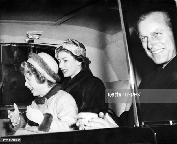Princess Anne expresses her joy at seeing her parents Prince Philip and Queen Elizabeth II again upon their return from Lisbon on February 22, 1957.