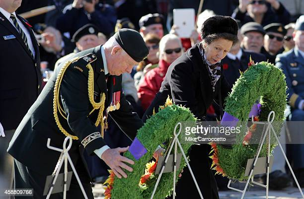 Princess Anne glances over at Governor General David Johnston as they each lay a wreath during this morning's Remembrance Day ceremony, November 11,...