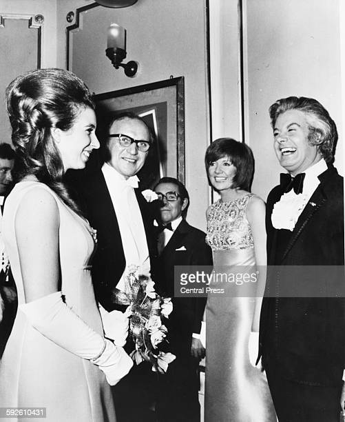 Princess Anne meeting entertainer Danny la Rue who is standing next to singer Cilla Black as she attends the Royal Variety Performance at the London...