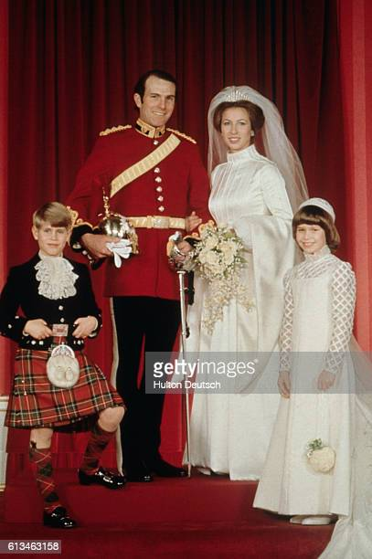 Princess Anne on her wedding day with her husband Mark Phillips, her younger brother Prince Edward, and cousin Lady Sarah Armstrong-Jones.