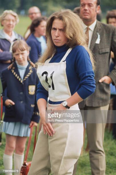 Princess Anne pictured adjusting her jodhpurs during her participation in the threeday eventing competition at Burghley Horse Trials at Burghley...