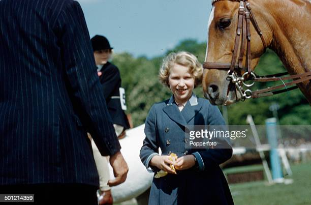 Princess Anne pictured beside a horse at a horse jumping event circa 1961