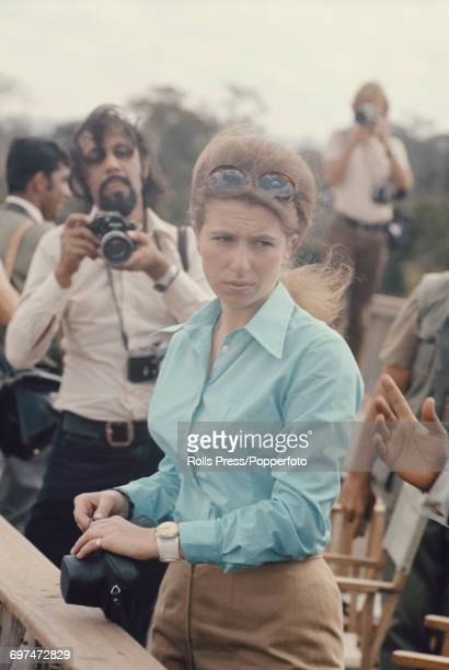 Princess Anne pictured holding a camera as press photographers surround her during a visit to Treetops Lodge in Aberdare National Park near Nyeni in...
