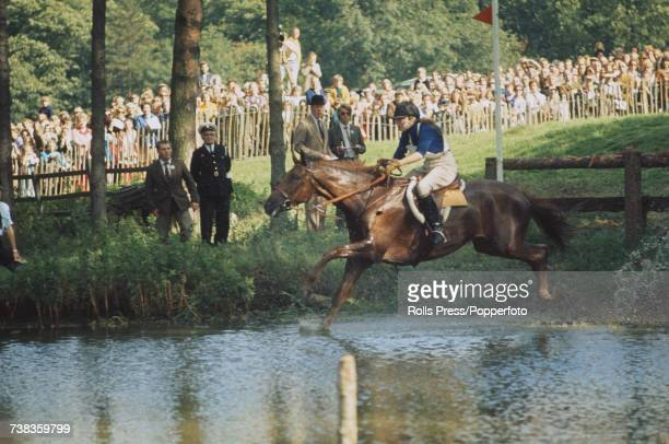 Princess Anne pictured riding her horse Doublet in to a water hazard in the three-day eventing competition at Burghley Horse Trials at Burghley House...