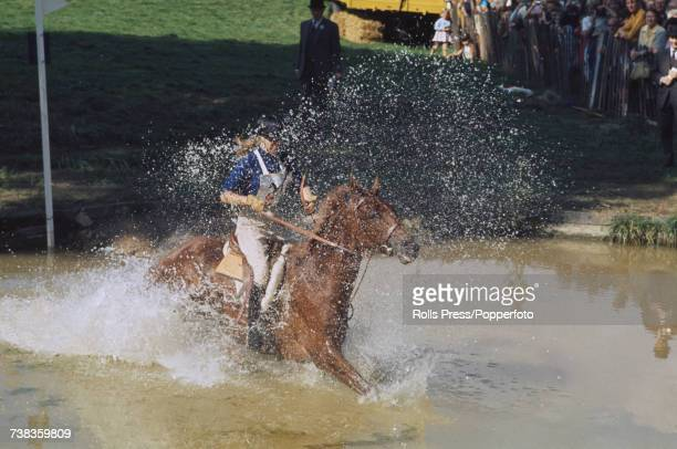 Princess Anne pictured riding her horse Doublet through a water hazard in the threeday eventing competition at Burghley Horse Trials at Burghley...