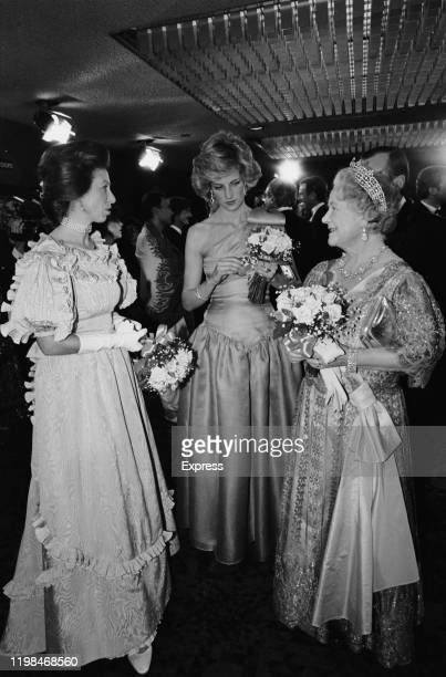 Princess Anne, Princess Diana and The Queen Mother , wearing evening gowns, at the premiere of David Lean's film 'A Passage To India', London, UK,...