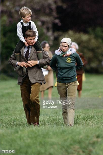 Princess Anne, Princess Royal and bodyguard David Robinson carry Zara and Peter Phillips on their shoulders at the Royal Windsor Horse Show