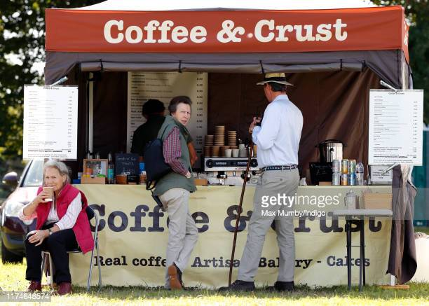 Princess Anne, Princess Royal and husband Sir Tim Laurence queue up at at pop-up coffee shop as they attend day 2 of the Whatley Manor Gatcombe...