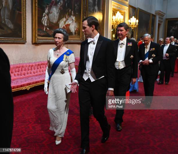 Princess Anne Princess Royal and Jared Kushner arrive through the East Gallery for a State Banquet at Buckingham Palace on June 3 2019 in London...
