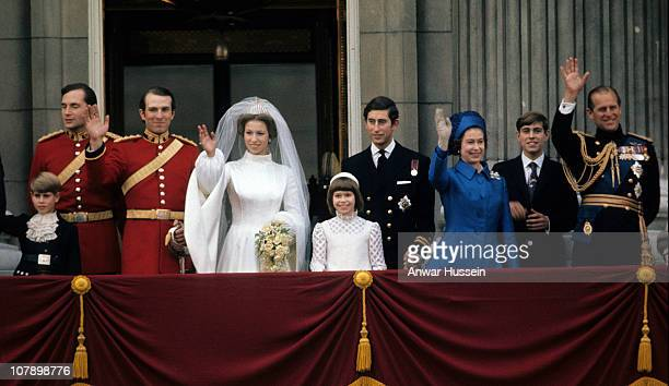 Princess Anne Princess Royal and Mark Phillips wave from the balcony of Buckingham Palace following their wedding with Prince Edward Earl of Wessex...