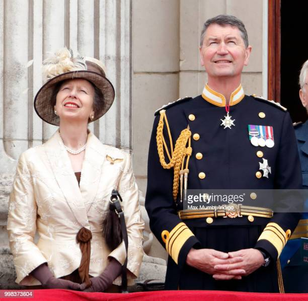 Princess Anne Princess Royal and Vice Admiral Sir Tim Laurence watch a flypast to mark the centenary of the Royal Air Force from the balcony of...
