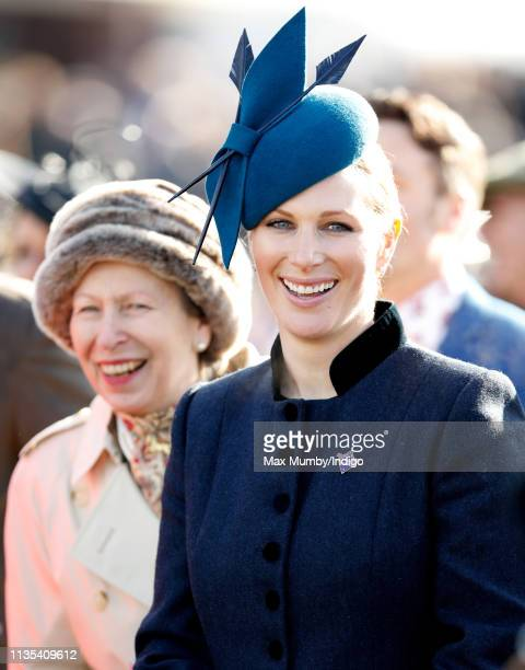 Princess Anne, Princess Royal and Zara Tindall watch the racing as they attend day 1 'Champion Day' of the Cheltenham Festival at Cheltenham...