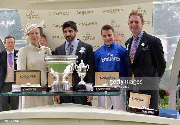 Princess Anne Princess Royal awards groomer Ameet Tikare jockey William Buick and breeder Charlie Appleby with the The King's Stand Stakes Cup during...
