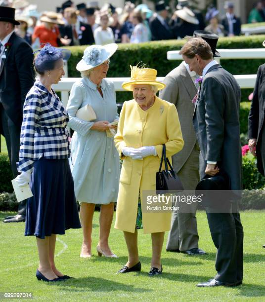 Princess Anne Princess Royal Camilla Duchess of Cornwall and Queen Elizabeth II in the parade ring on day 2 of Royal Ascot at Ascot Racecourse on...
