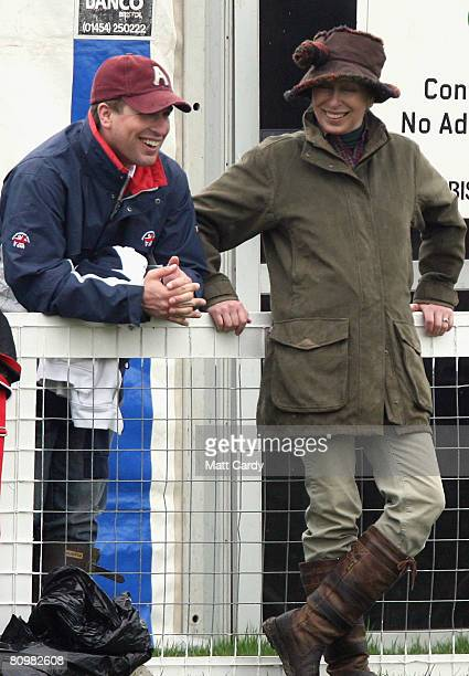 Princess Anne Princess Royal jokes with her son Peter Phillips as they watch the horses warming up for the show jumping during the Badminton Horse...