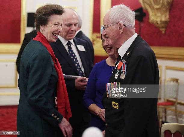 Princess Anne Princess Royal jokes with Normandy veteran George Joseph White of the Queen's Royal Artillery during a Christmas Party at St James's...