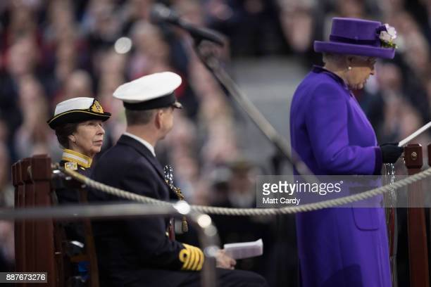 Princess Anne Princess Royal looks on as Queen Elizabeth II speaks during the Commissioning Ceremony of HMS Queen Elizabeth at HM Naval Base on...