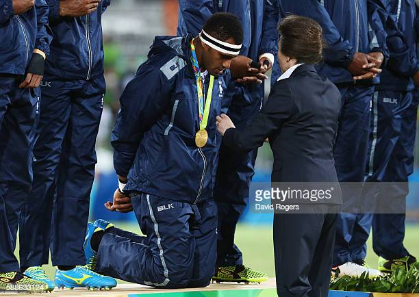 Princess Anne Princess Royal presents the Fiji team with their gold medals during the medal ceremony for the Men's Rugby Sevens on Day 6 of the Rio...