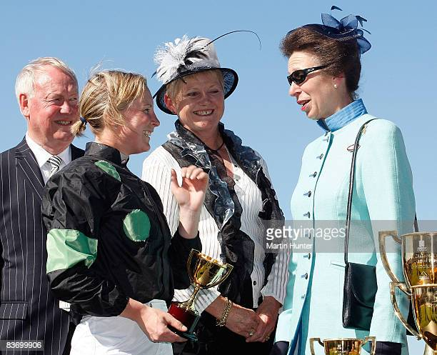 Princess Anne Princess Royal presents the trophy to jockey Kelly Myers after Hoorang's victory in the New Zealand Cup during a visit to the...