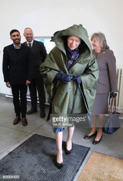 Princess Anne Princess Royal President of the UK Fashion and Textile Association puts on a coat given to her on a visit to officially open the...