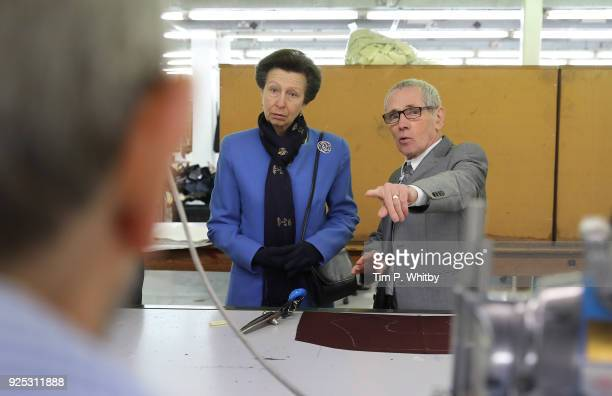 Princess Anne Princess Royal President of the UK Fashion and Textile Association meets retired cutter Robert Bagan on a visit to officially open the...