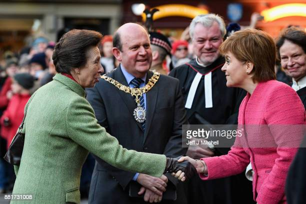 Princess Anne Princess Royal shakes hands with First Minister of Scotland Nicola Sturgeon as she arrives at St Giles Cathedral for a Commemoration...