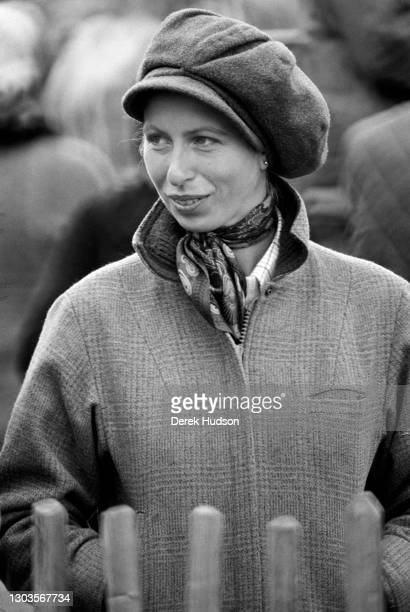Circa 1975: Princess Anne, Princess Royal sporting a stylish buffoon style tweed cap with a Barbour waterproof jacket at the five day event Badminton...