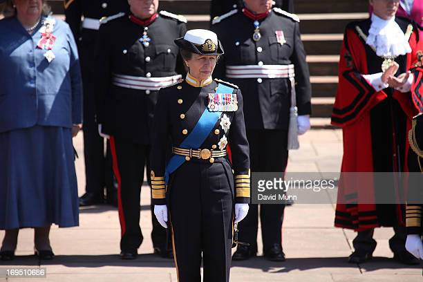 Princess Anne, Princess Royal takes the salute during a commemorative parade marking the 70th anniversary of the Battle of the Atlantic on May 26,...